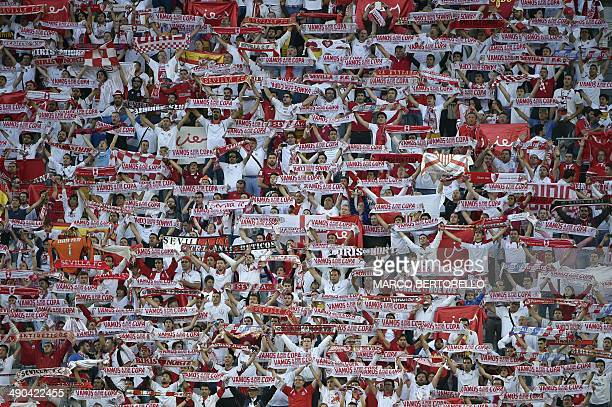 Sevilla fans raise scarves as they sing prior to the start of the UEFA Europa league final football match between Benfica and Sevilla on May 14 2014...