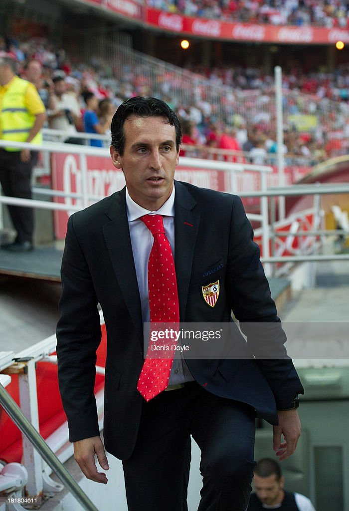 Sevilla FC head coach <a gi-track='captionPersonalityLinkClicked' href=/galleries/search?phrase=Unai+Emery&family=editorial&specificpeople=4599654 ng-click='$event.stopPropagation()'>Unai Emery</a> takes to the field for the La liga match between Sevilla FC and Rayo Vallecano de Madrid at Estadio Ramon Sanchez Pizjuan on September 25, 2013 in Seville, Spain.