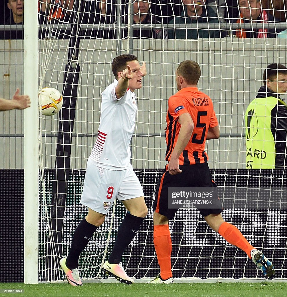 Sevilla FC Kevin Gameiro (L) reacts next to Olexandr Kucher of Shakhtar Donetsk after Vitolo scored a goal for Sevilla during the UEFA Europa League semi-final football match FC Shakhtar Donetsk vs Sevilla FC at the Arena Lviv stadium in Lviv on April 28, 2016. / AFP / JANEK