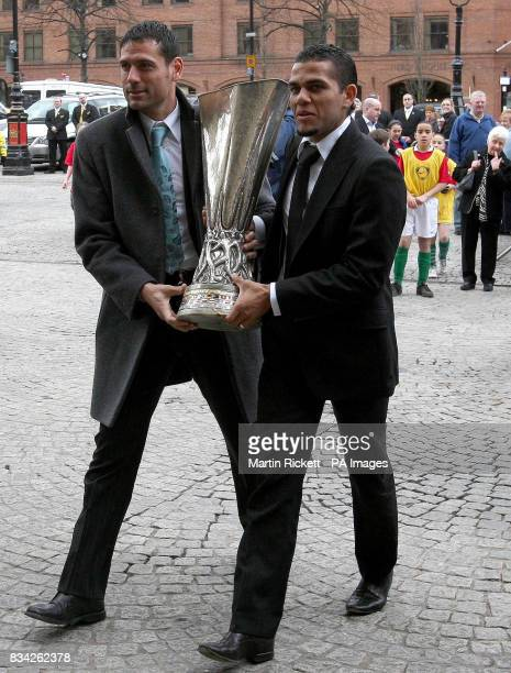 Sevilla FC players Andrs Palop and Daniel Alves arrive with the UEFA Cup during the handover at the Town Hall Manchester