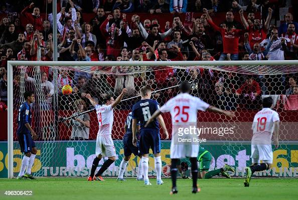 Sevilla FC players celebrate after scoring their opening goal during the La Liga match between Sevilla FC and Real Madrid CF at Estadio Ramon Sanchez...