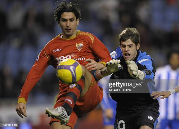 Sevilla FC´s french Julien Escude touches the ball next to Deporivo Coruna´s goalkeeper Fabricio Agosto during their King's Cup 2nd league football...