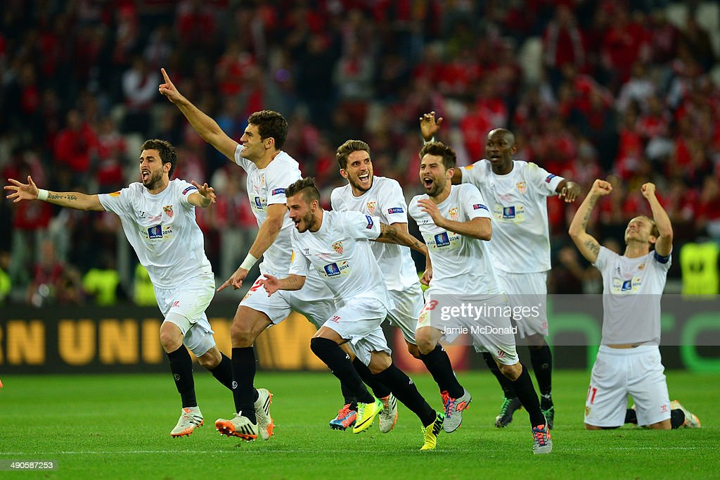 Sevilla players celebrate after Kevin Gameiro of Sevilla (not pictured) scores the winning penalty in the shoot out during the UEFA Europa League Final match between Sevilla FC and SL Benfica at Juventus Stadium on May 14, 2014 in Turin, Italy.