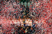 Sevilla players celebrate as Ivan Rakitic of Sevilla lifts the Europa League trophy during the UEFA Europa League Final match between Sevilla FC and...