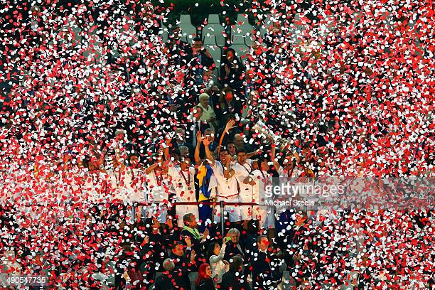 Sevilla players celebrate as Ivan Rakitic of Sevilla lifts the Europa League trophy during the UEFA Europa League Final match between Sevilla FC and...