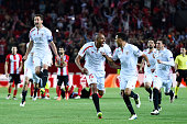 Sevilla players celebrate victory after the penalty shoot out during the UEFA Europa League quarter final second leg match between Sevilla and...