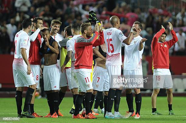 Sevilla players celebrates their victory at the end of the Spanish league football match Sevilla FC vs Real Madrid CF at the Ramon Sanchez Pizjuan...