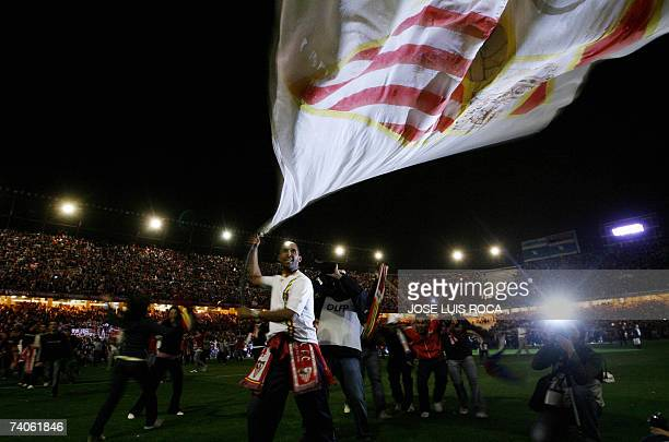 Sevilla supporters celebrate after beating Osasuna 20 in their UEFA Cup semifinal football match at the Sanchez Pizjuan stadium in Sevilla 03 May...