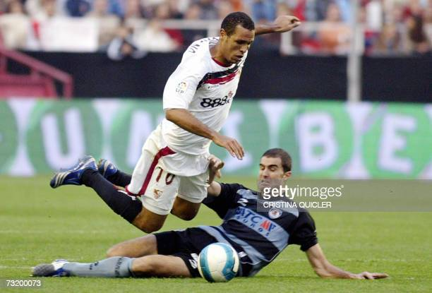 Sevilla's Brazilian Luis Fabiano vies with Real Sociedad's Yugoslavian Kovacevic during their Spanish league football match at the Sanchez Pizjuan...