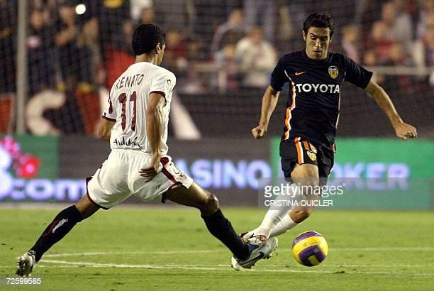 Sevilla's Brazilian Renato Dirnei Florencio vies with Valencia's Portuguese Hugo Viana during a Spanish league football match at the Sanchez Pizjuan...