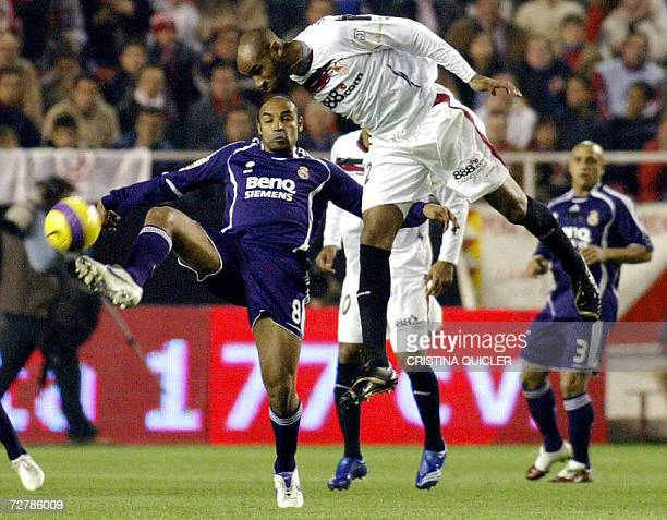 Sevilla's French forward Freddies Kanoute heads the ball by Real Madrid's Brazilian Emerson Ferreira during a Spanish league football match at the...
