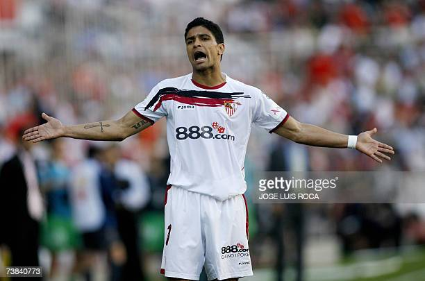Seville's Renato reacts after a challenge during a Spanish league football match against Racing at the Ramon Sanchez Pizjuan stadium in Seville 08...