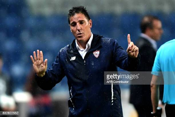 Sevilla's Argentine head coach Eduardo Berizzo gestures during the UEFA Champions League playoff first leg football match between Istanbul Basaksehir...