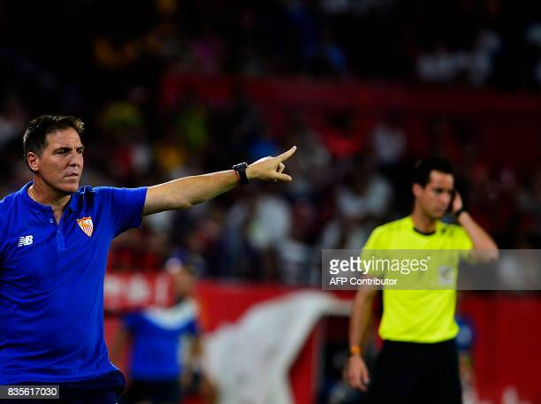 Sevilla's Argentinian coach Eduardo Berizzo gives instructions to the players during the Spanish league football match Sevilla FC vs Espanyol on...