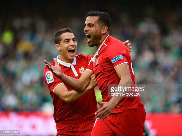 Sevilla's Argentinian defender Gabriel Mercado celebrates after scoring a goal with Sevilla's French forward Wissam Ben Yedder during the Spanish...