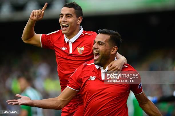 Sevilla's Argentinian defender Gabriel Mercado celebrates after scoring a goal with Sevilla's French forward Wissam Ben Yedder during the Spanish...