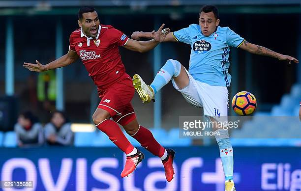 Sevilla's Argentinian defender Gabriel Mercado vies with Celta Vigo's Chilean forward Fabian Orellana during the Spanish league football match RC...