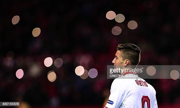 Sevilla's Argentinian forward Luciano Vietto celebrates a goal with teammates during the Spanish league football match Sevilla FC vs Malaga CF at the...