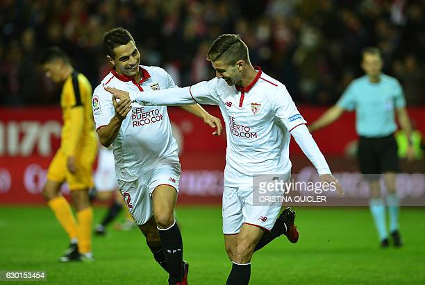 Sevilla's Argentinian forward Luciano Vietto celebrates a goal with Sevilla's French forward Wissam Ben Yedder during the Spanish league football...