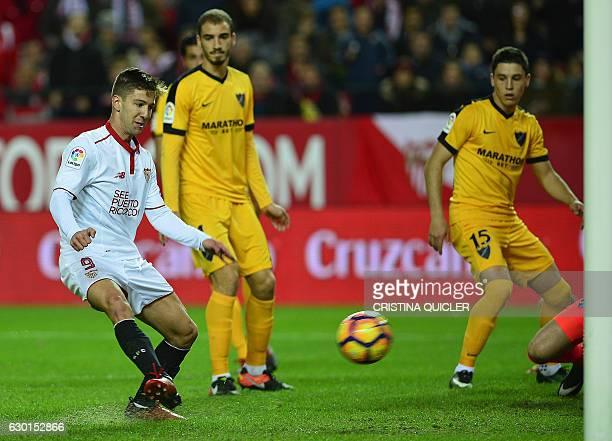 Sevilla's Argentinian forward Luciano Vietto scores a goal during the Spanish league football match Sevilla FC vs Malaga CF at the Ramon Sanchez...