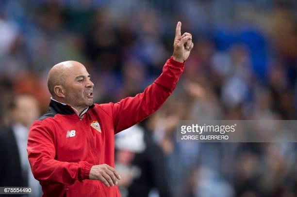 Sevilla's Argentinian head coach Jorge Sampaoli gestures on the sideline during the Spanish league football match Malaga CF vs Sevilla FC at La...