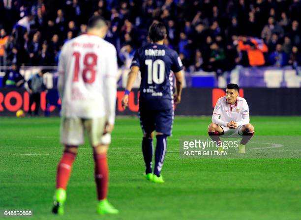 Sevilla's Argentinian midfielder Claudio Matias Kranevitter crouches on the pitch at the end of the Spanish league football match Deportivo Alaves vs...