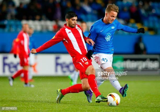 Sevilla's Argentinian midfielder Ever Banega and Molde's Sander Svendsen vie during the UEFA Europa League Round of 32 match football between Molde...