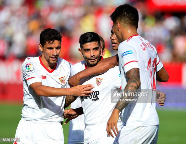 Sevilla's Argentinian midfielder Ever Banega celebrates a goal with teammates during the Spanish league football match Sevilla FC vs Malaga CF at the...