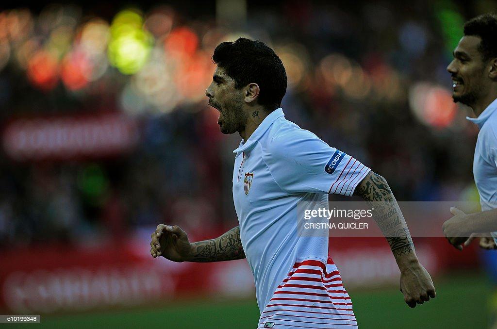 Sevilla's Argentinian midfielder Ever Banega celebrates after scoring during the Spanish league football match FC Sevilla vs UD Las Palmas at the Ramon Sanchez Pizjuan stadium in Sevilla on February 14, 2016. / AFP / CRISTINA QUICLER