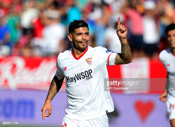 Sevilla's Argentinian midfielder Ever Banega celebrates after scoring a goal during the Spanish league football match Sevilla FC vs Malaga CF at the...