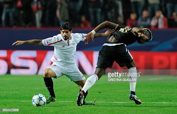 TOPSHOT Sevilla's Argentinian midfielder Ever Banega vies with Juventus' French midfielder Paul Pogba during the UEFA Champions League Group D...