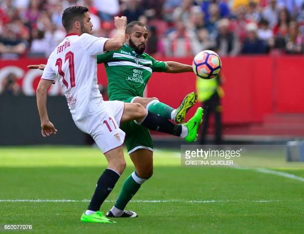 Sevilla's Argentinian midfielder Joaquin Correa vies with Leganes' Moroccan forward Nabil El Zhar during the Spanish league football match Sevilla FC...