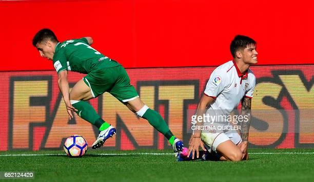 Sevilla's Argentinian midfielder Joaquin Correa vies with Leganes' defender Unai Bustinza during the Spanish league football match Sevilla FC vs Club...