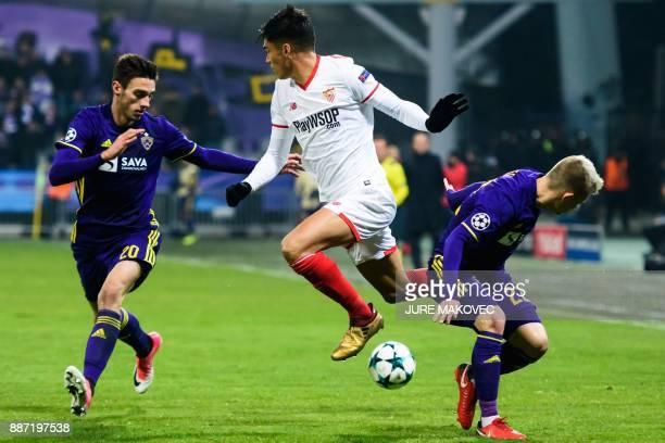 Sevilla's Argentinian midfielder Joaquin Correa vies with Maribor's Slovenian forward Gregor Bajde and Slovenian defender Martin Milec during the...