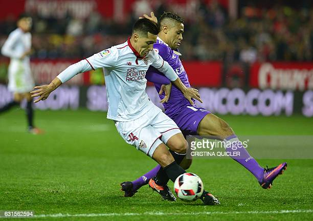 Sevilla's Argentinian midfielder Matias Kranevitter vies with Real Madrid's Domenican forward Mariano during the Spanish Copa del Rey round of 16...