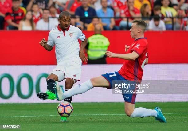 Sevilla's Brazilian defender Mariano controls the ball beside Osasuna's defender Carlos Clerc during the Spanish league football match Sevilla FC vs...