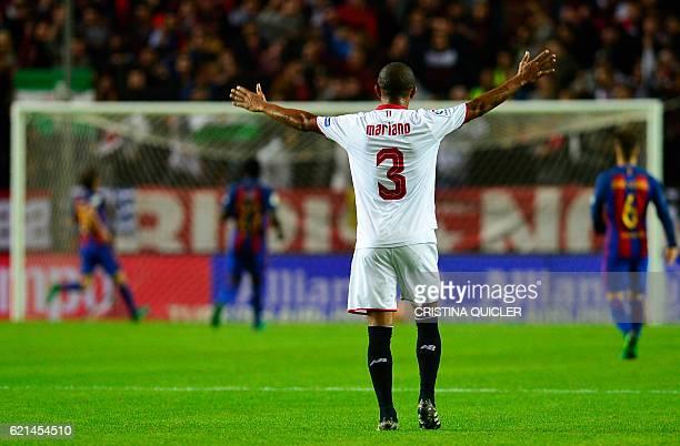 Sevilla's Brazilian defender Mariano Ferreira gestures after Sevilla's midfielder Vitolo scored during the Spanish league football match Sevilla FC...