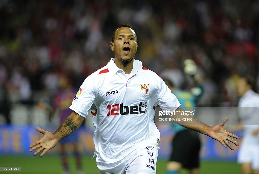 Sevilla's Brazilian forward Luis Fabiano celebrates after scoring against Barcelona during a Spanish league football match against Sevilla at Sanchez Pizjuan stadium in Sevilla, on May 8, 2010. Barcelona won 3-2.