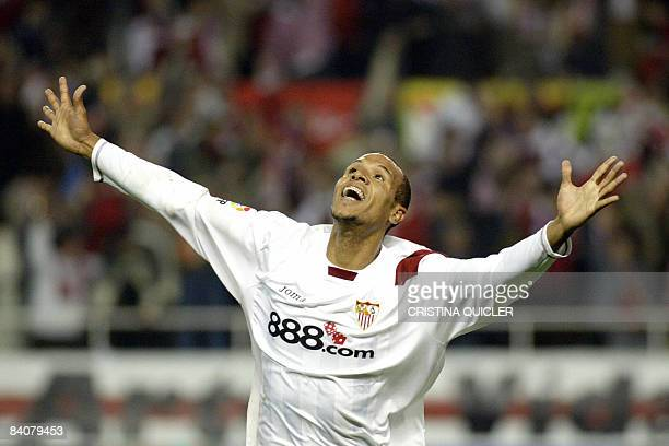Sevilla's Brazilian Luis Fabiano celebrates after scoring against Betis during a Spanish league derby football match at the Sanchez Pizjuan stadium...
