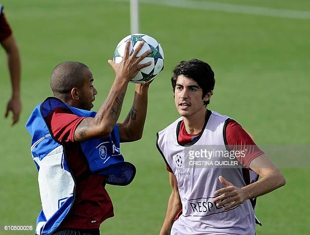 Sevilla's Brazilian Mariano Ferreira and forward Carlos Fernandez attend a training session at the Ciudad Deportiva training grounds in Sevilla on...