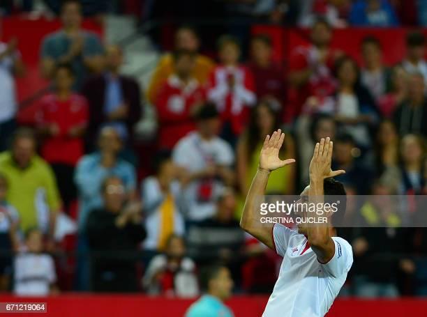 Sevilla's Brazilian midfielder Ganso celebrates after scoring during the Spanish league football match Sevilla FC vs Granada FC at the Ramon Sanchez...