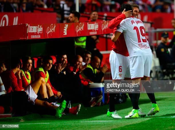 Sevilla's Brazilian midfielder Ganso celebrates with Sevilla's Portuguese midfielder Daniel Carrico after scoring during the Spanish league football...