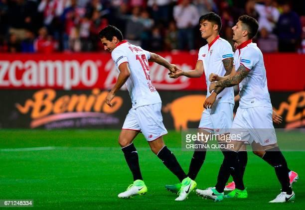 Sevilla's Brazilian midfielder Ganso celebrates with teammates after scoring during the Spanish league football match Sevilla FC vs Granada FC at the...