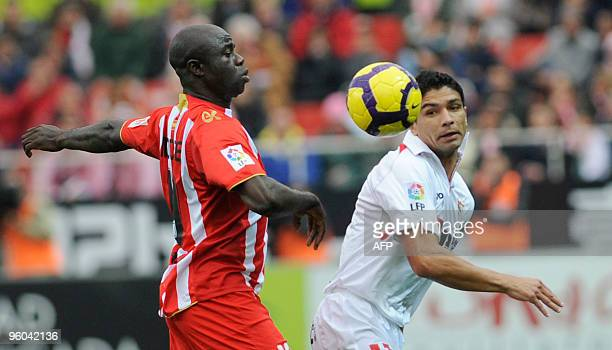 Sevilla's Brazilian midfielder Renato vies with Almeria's midfielder M Bami during a Spanish league football match at Sanchez Pizjuan stadium in...