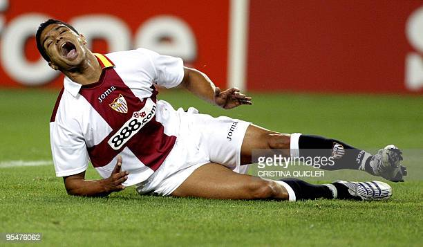 Sevilla's Brazilian Renato Dirnei shouts in pain after being tackled during a Champions League football match against Steaua Bucarest at the Sanchez...