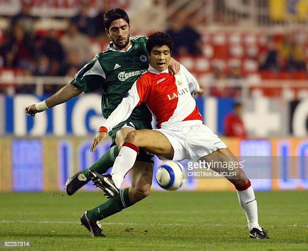 Sevilla's Brazilian Renato Dirnei vies for the ball with Panathinaikos's Konstantinou Michalis during their UEFA cup football match at the Sanchez...