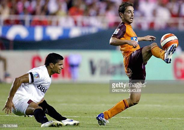 Sevilla's Brazilian Renato Dirnei vies with Recreativo de Huelva's Eduardo Moya during a Spanish league football match at the Sanchez Pizjuan stadium...