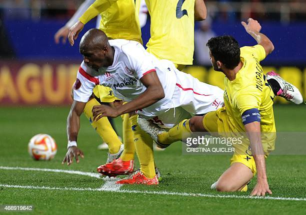 Sevilla's Cameroonian midfielder Stephane Mbia vies with Villarreal's Argentinian defender Mateo Musacchio during the Europa League football match FC...