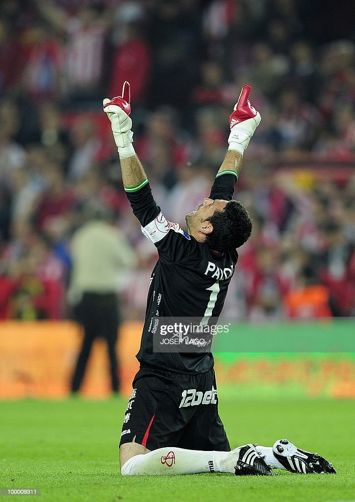 Sevilla's captain goalkeeper Andres Palop celebrates after winning the King's Cup final match against Atletico Madrid at the Camp Nou stadium in Barcelona on May 19, 2010. Sevilla won 2-0.