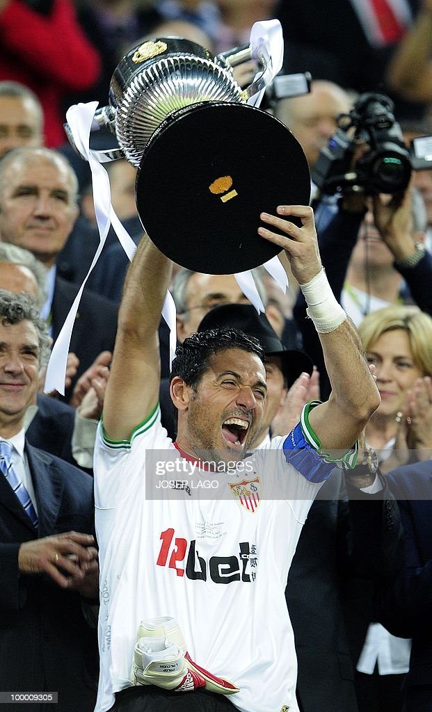 Sevilla's captain goalkeeper Andres Palop celebrates with the trophy after winning the King's Cup final match against Atletico Madrid at the Camp Nou stadium in Barcelona on May 19, 2010. Sevilla won 2-0.